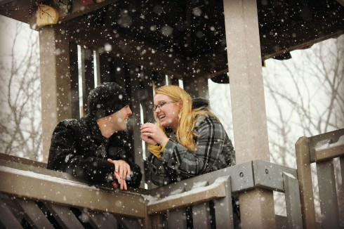A couple laughing in the snow